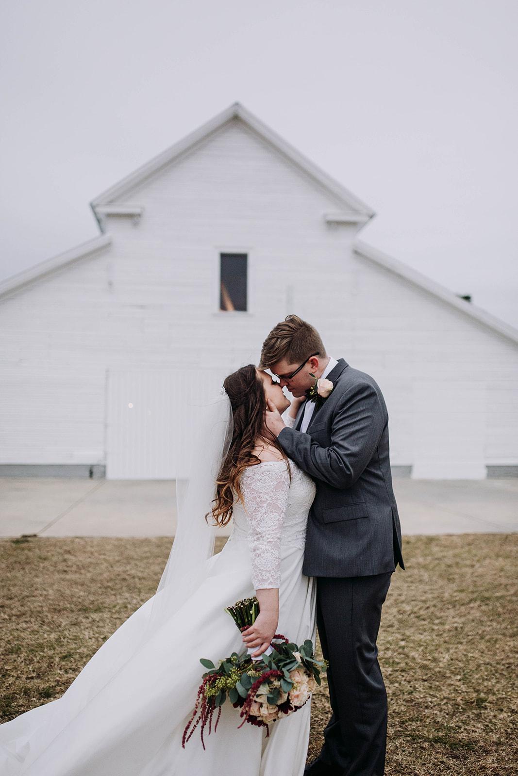 kissing in fron of barn.jpg
