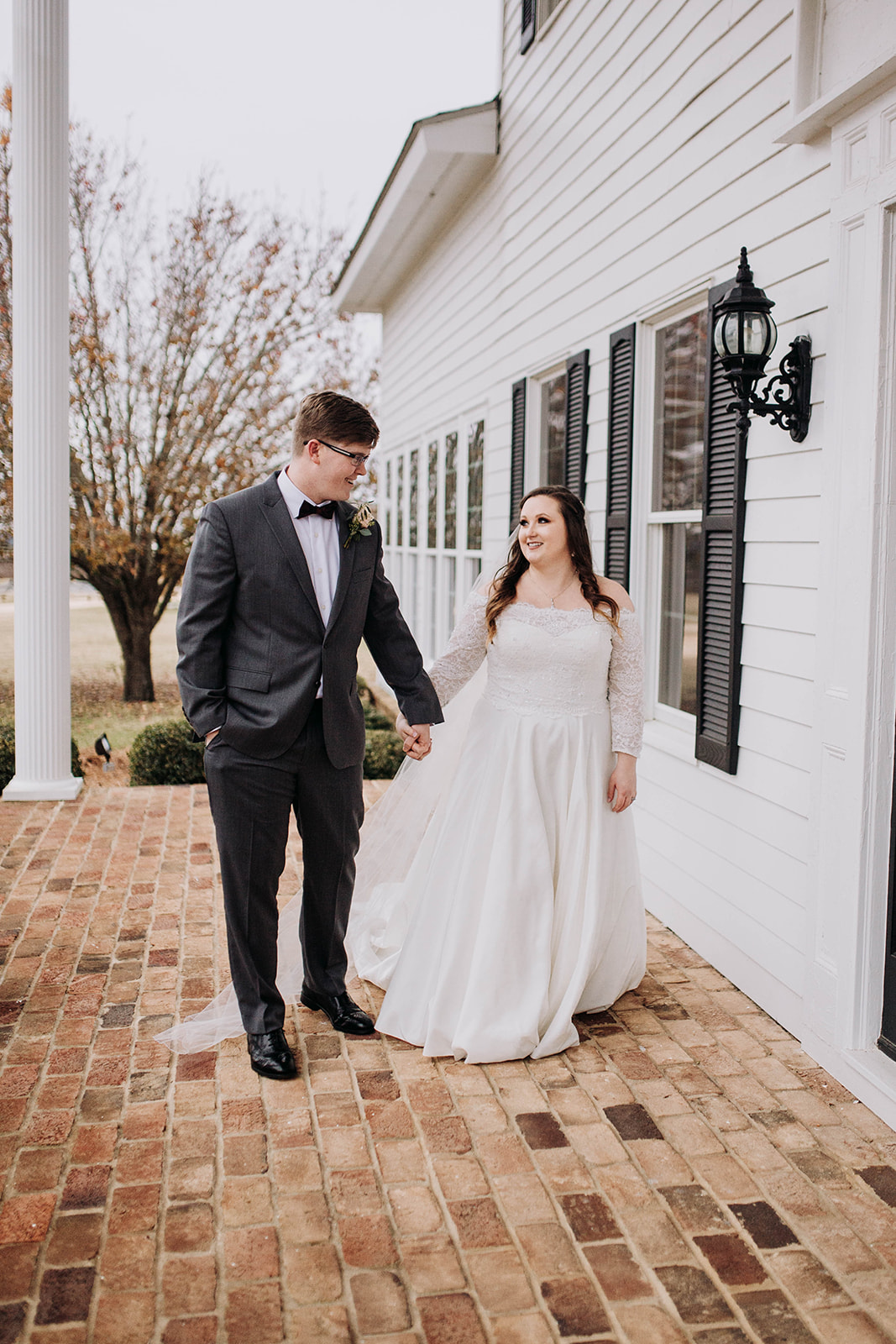 couple in front of house.jpg