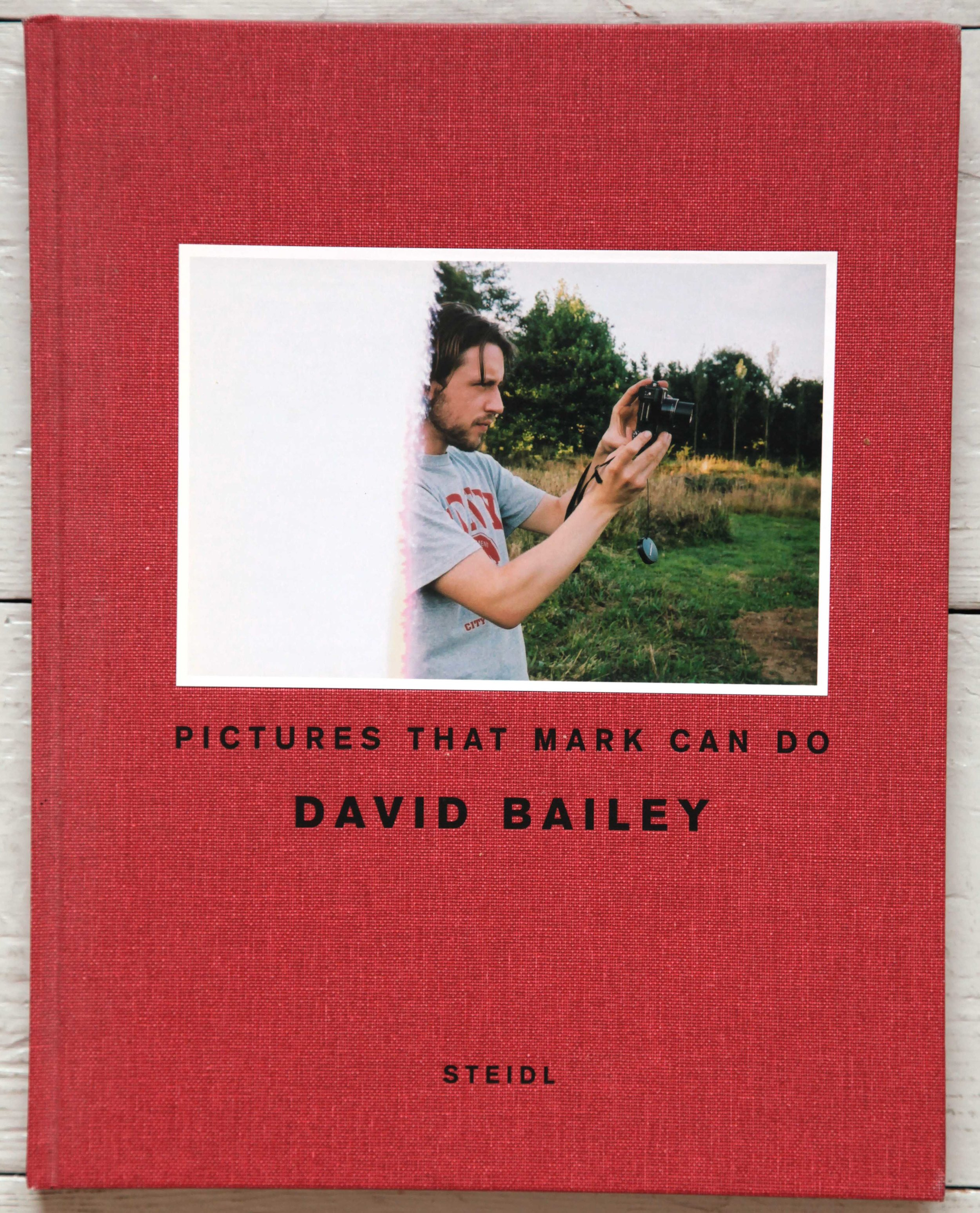 £100 Signed Copy of David Bailey's 'Pictures That Mark Can Do'. First edition. Published by Steidl, Gottingen (2007). Hardback. - The snapshot is a part of our visual culture and many photographs have been taken millions of times, with just slight variations, such as the identity of the people in a family portrait. Bailey also takes such snaps, images imbued with a sense of ease and freedom yet which in his hands carry much greater weight and significance. He believes these photographs appear so easy that even Mark, his assistant, could have made them. But Mark didn't sign this copy, David Bailey did! This is a second-hand copy kindly donated by Brett Rogers, Director Photographers' Gallery.