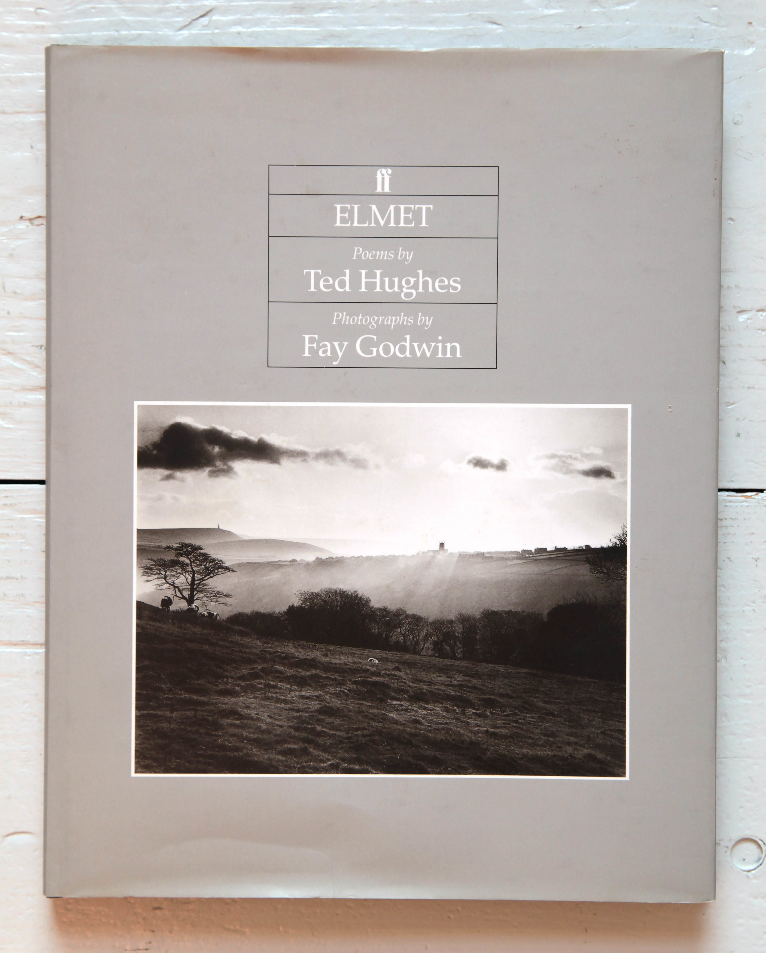 £100 Signed Copy of Fay Godwin's 'Remains of Elmet' with poems by Ted Hughes. Published by Faber and Faber, London (1994). Hardback. - First edition of this revised version - with added poems and more photographs. Fay Godwin's black and white landscapes taken in the Calder valley and the Poet Laurette's response to her exquisite images. This copy has minor scuffing to the dust jacket, but otherwise is in excellent condition, and has been kindly donated by Brett Rogers, Director Photographers' Gallery. Signed by Fay Godwin.