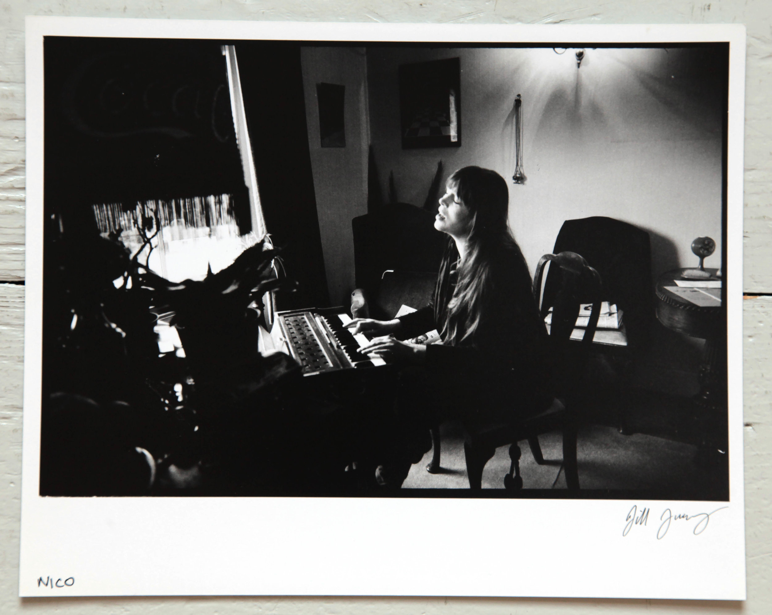 "£100 Unique 10"" x 8"" printer's proof: Nico, Hampstead, 1978. Signed by Jill Furmanovsky. - Donated by the founder of Rock Archive from her personal collection. This image was taken while the ex-Velvet Underground singer was rehearsing in a flat in London and accompanied a Sounds interview in April 1978."
