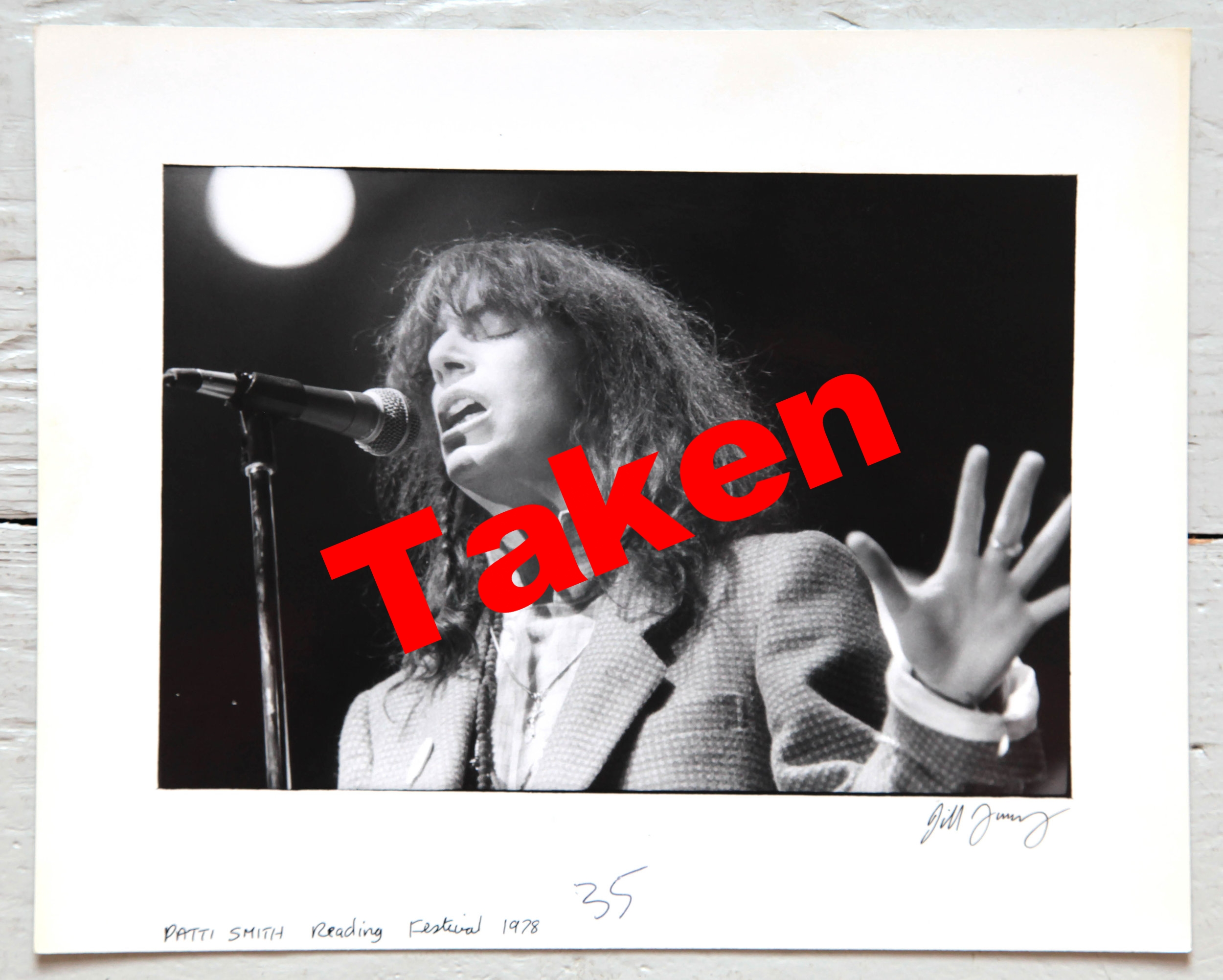 "£100 Unique 10"" x 8"" printer's proof: Patti Smith, Reading Festival, 1978. Signed by Jill Furmanovsky. - Live shot of the singer and poet during one of her early UK tours. Donated by the founder of Rock Archive from her personal collection, this proof print produced for music weekly Sounds is a one-off with original publication mark-ups on the reverse."