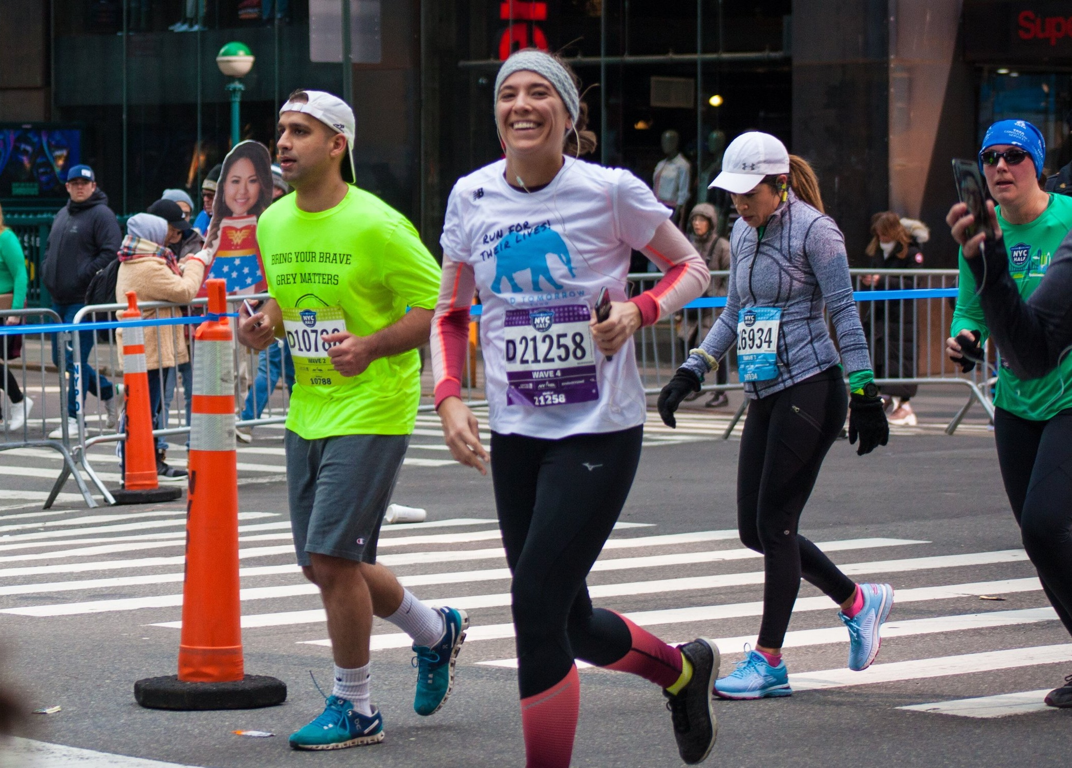 Elia Auchane   smiles as she passes Mile 11 north of Times Square in Manhattan.