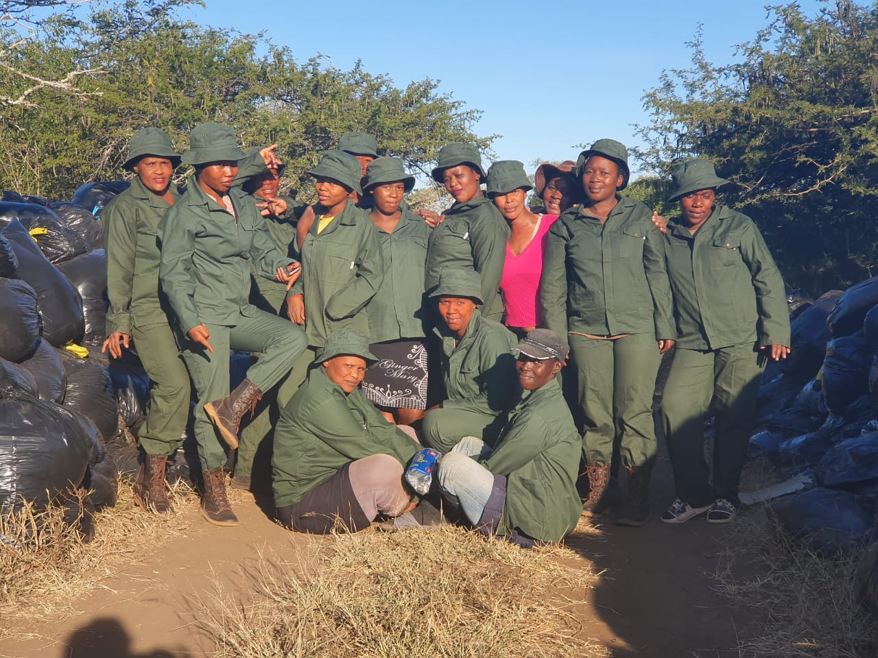 Team photo of the 14 Green Mambas, employed by Wild Tomorrow Fund for green and sustainable jobs.