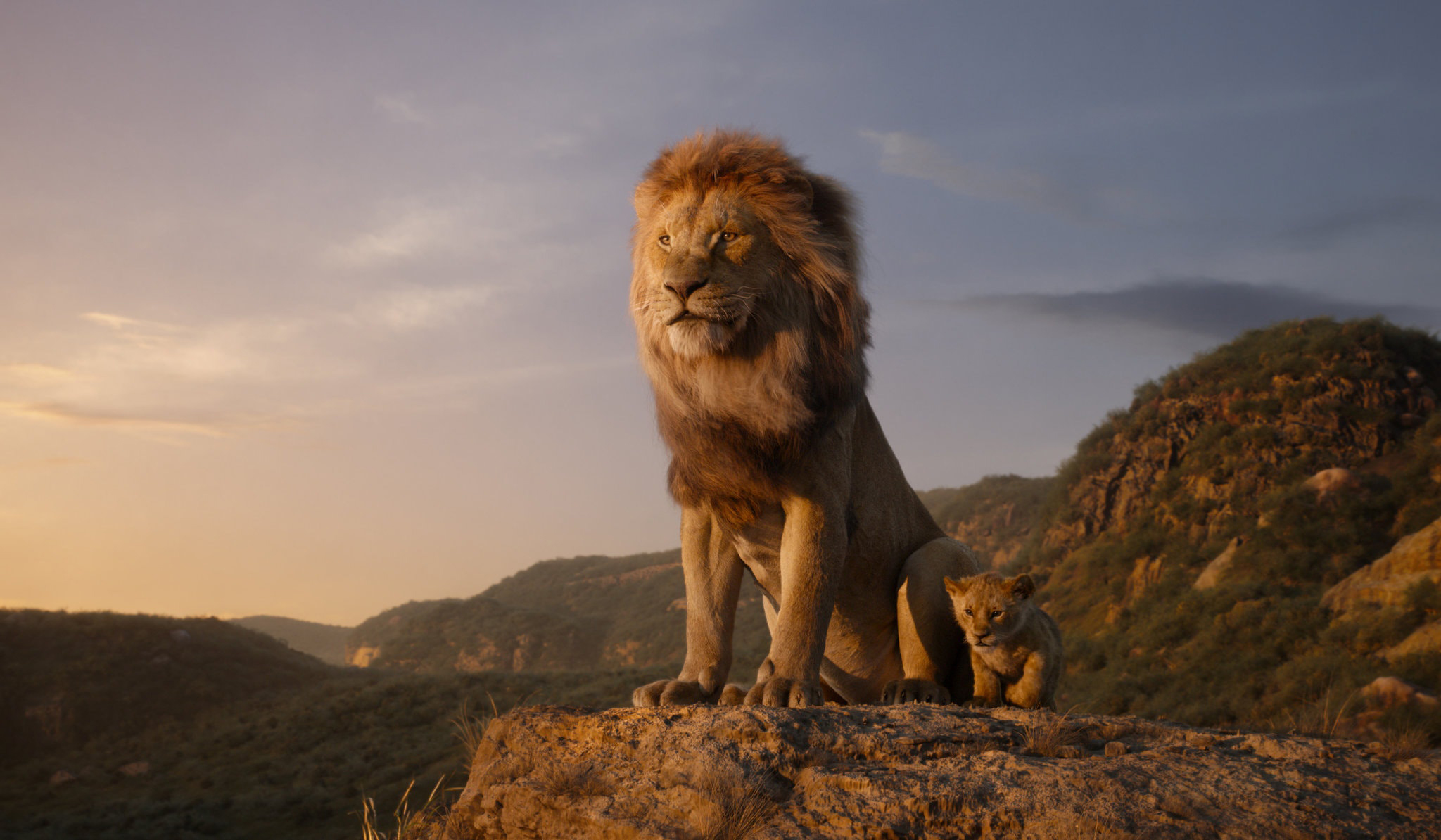 """Mufasa and his cub, Simba, in the new """"The Lion King.""""  Credit: Disney"""