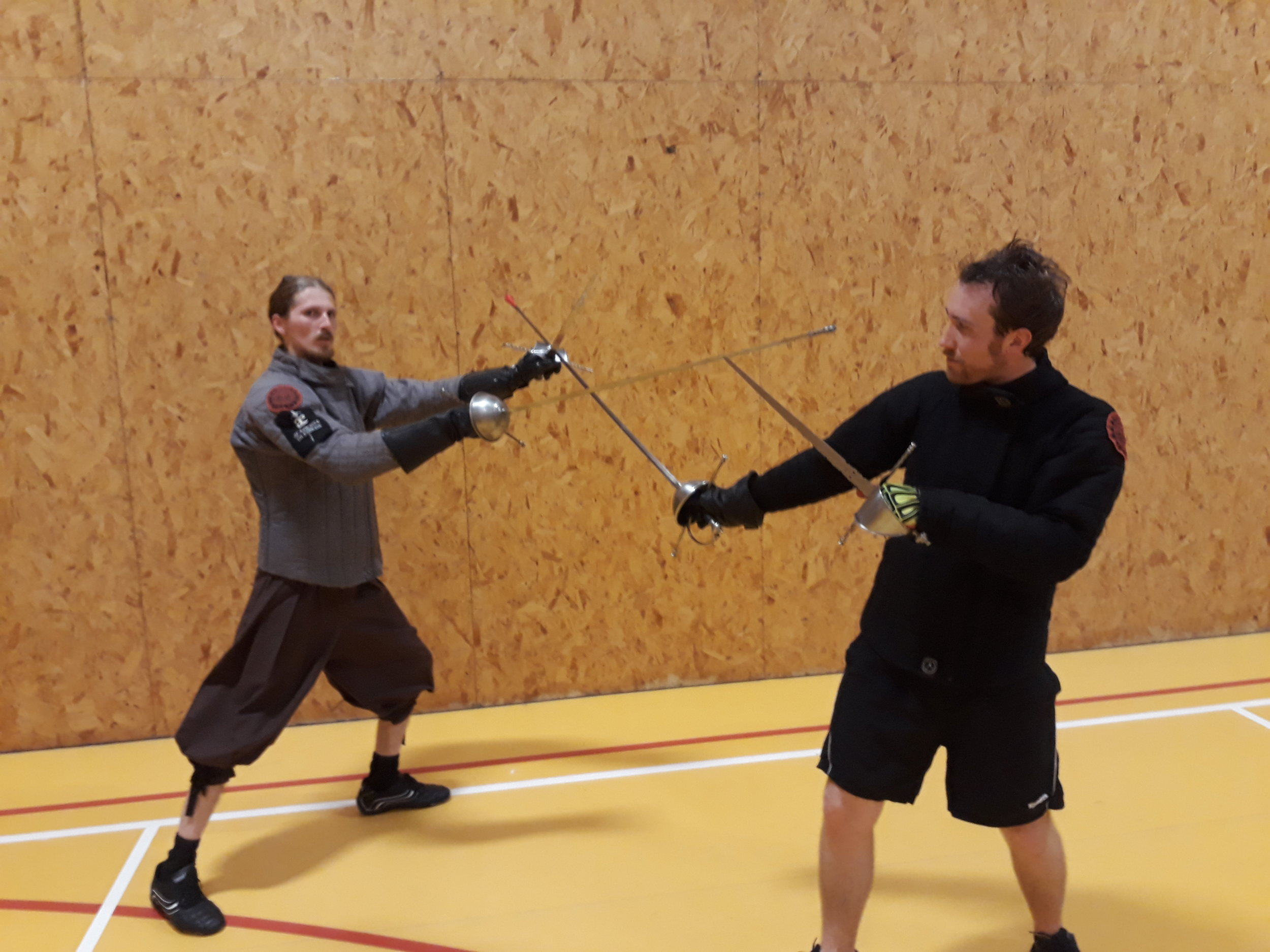 Picture D stepping diagonally to the left (transvers step) and striking the opponent with the point while controling the opponents sword with the dagger..jpg
