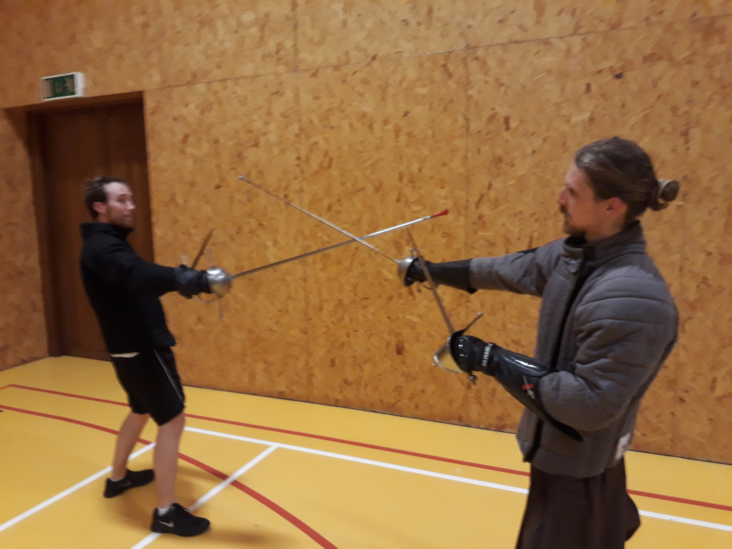 Picture F place your blade on the outside and take control of the opponents by pushing it off to your right..jpg