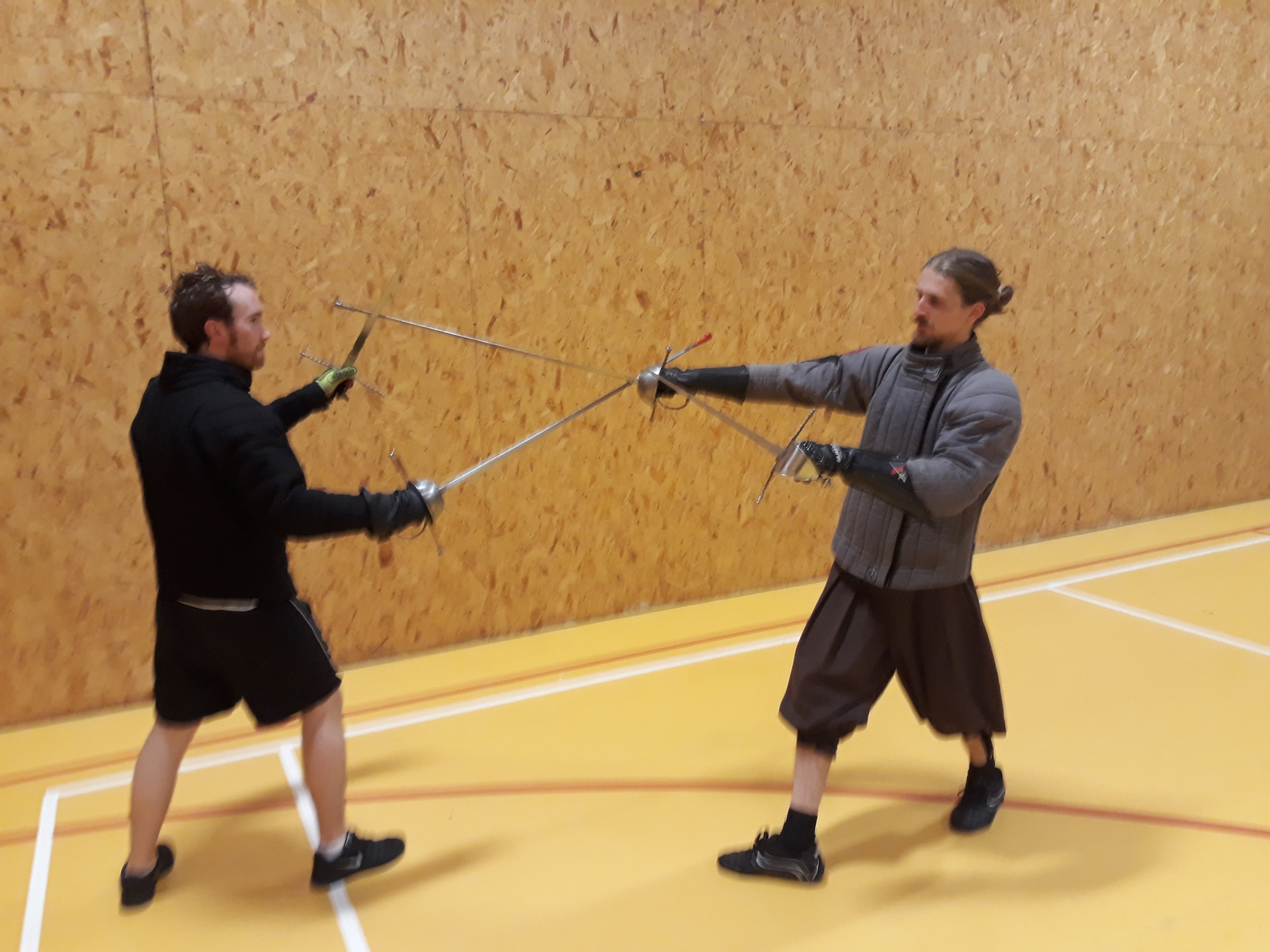 Picture G stepping a diagonal stransvers step to the right with the right leg and thrusting with the sword..jpg