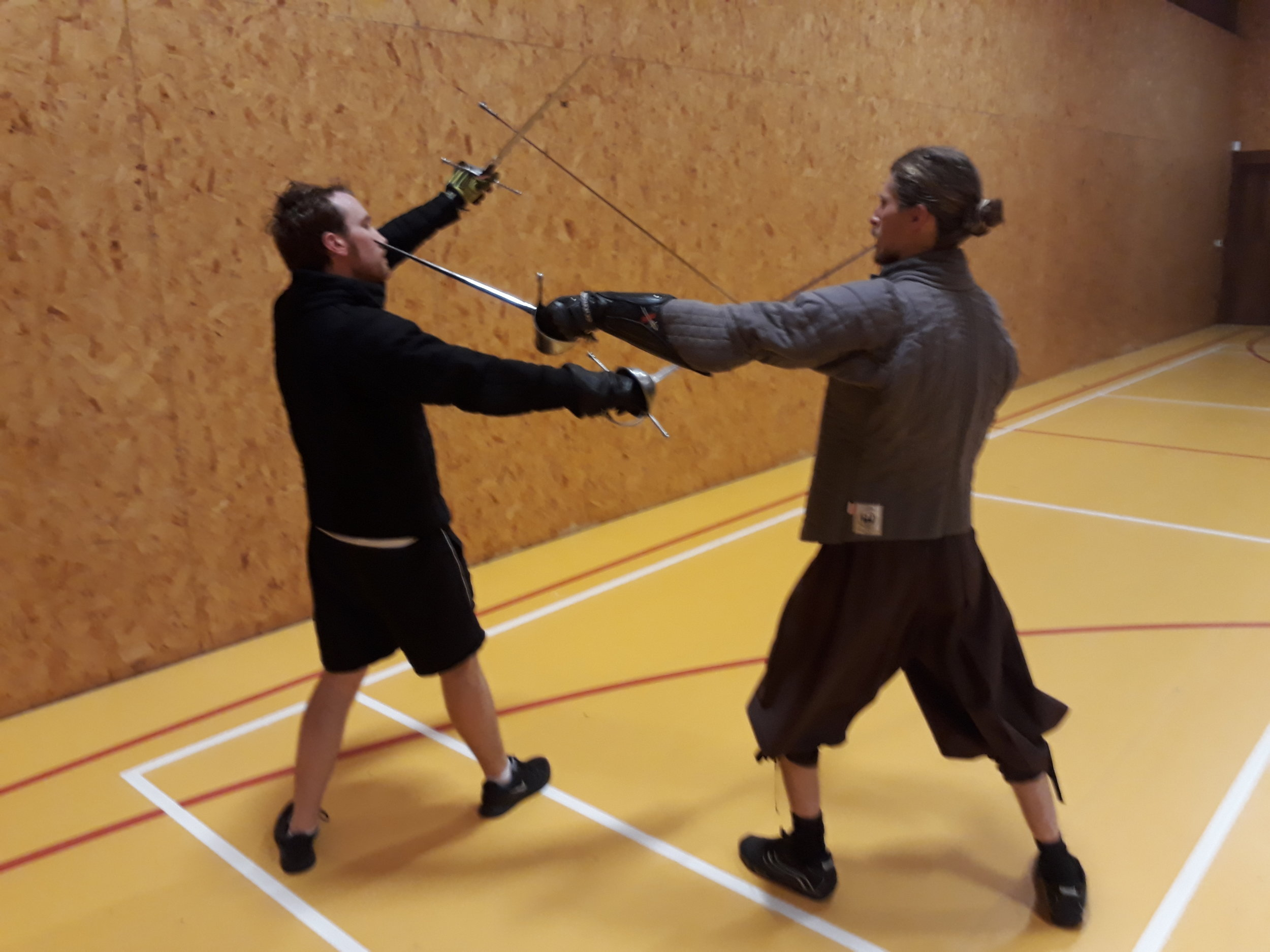 Picture H perform a curved step (circular step) with your left leg brining your dagger in and thrusting to the face or chest,underarm of the opponent..jpg