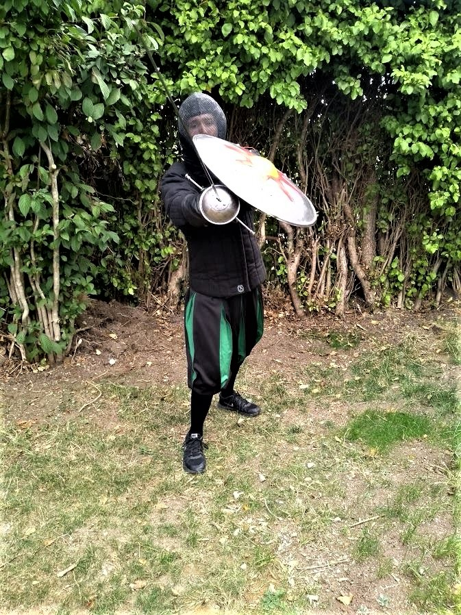 Student matt O Brien demonstrates a thrust with sword and Rodela.jpg