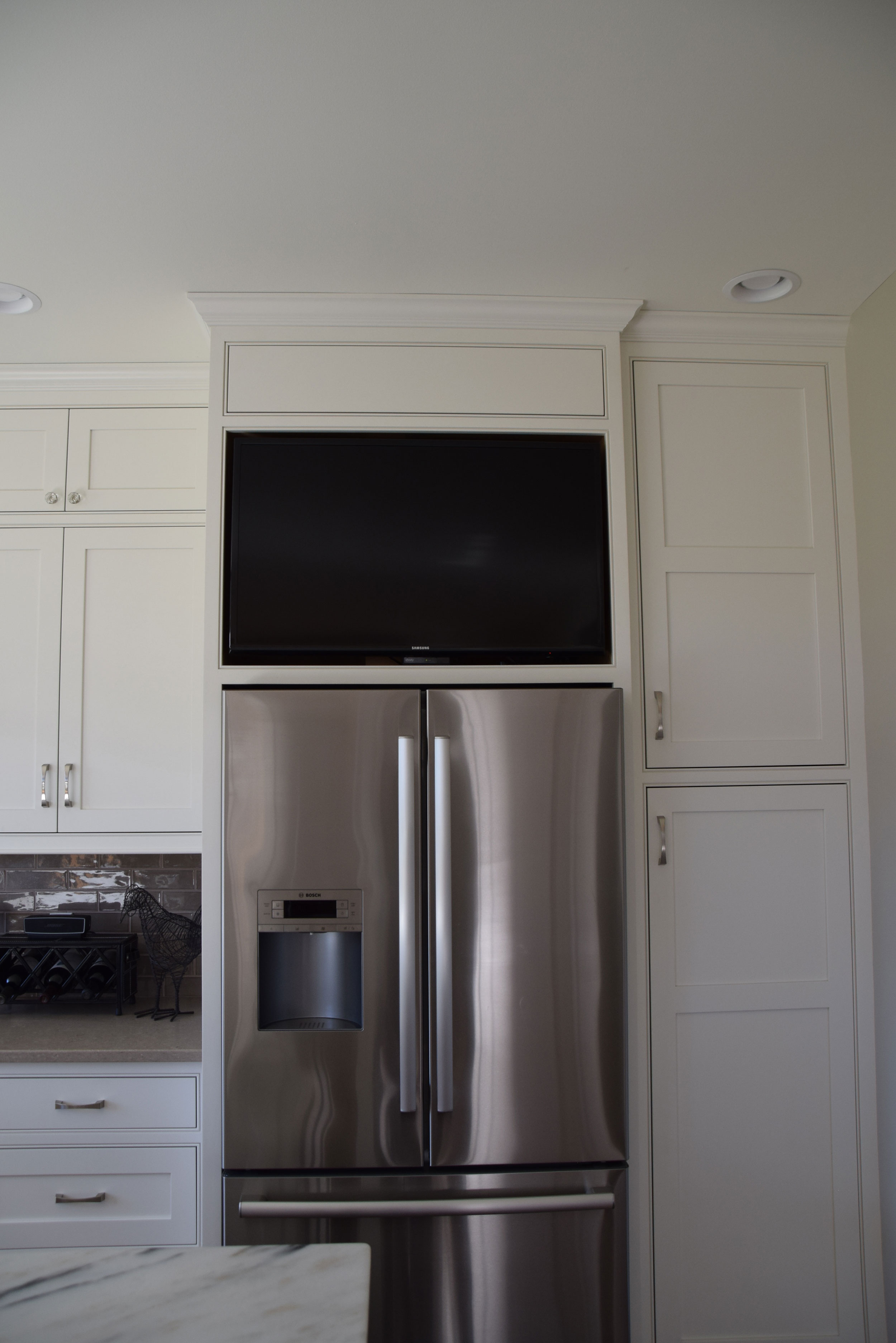 Bright White Kitchen - TV over Fridge