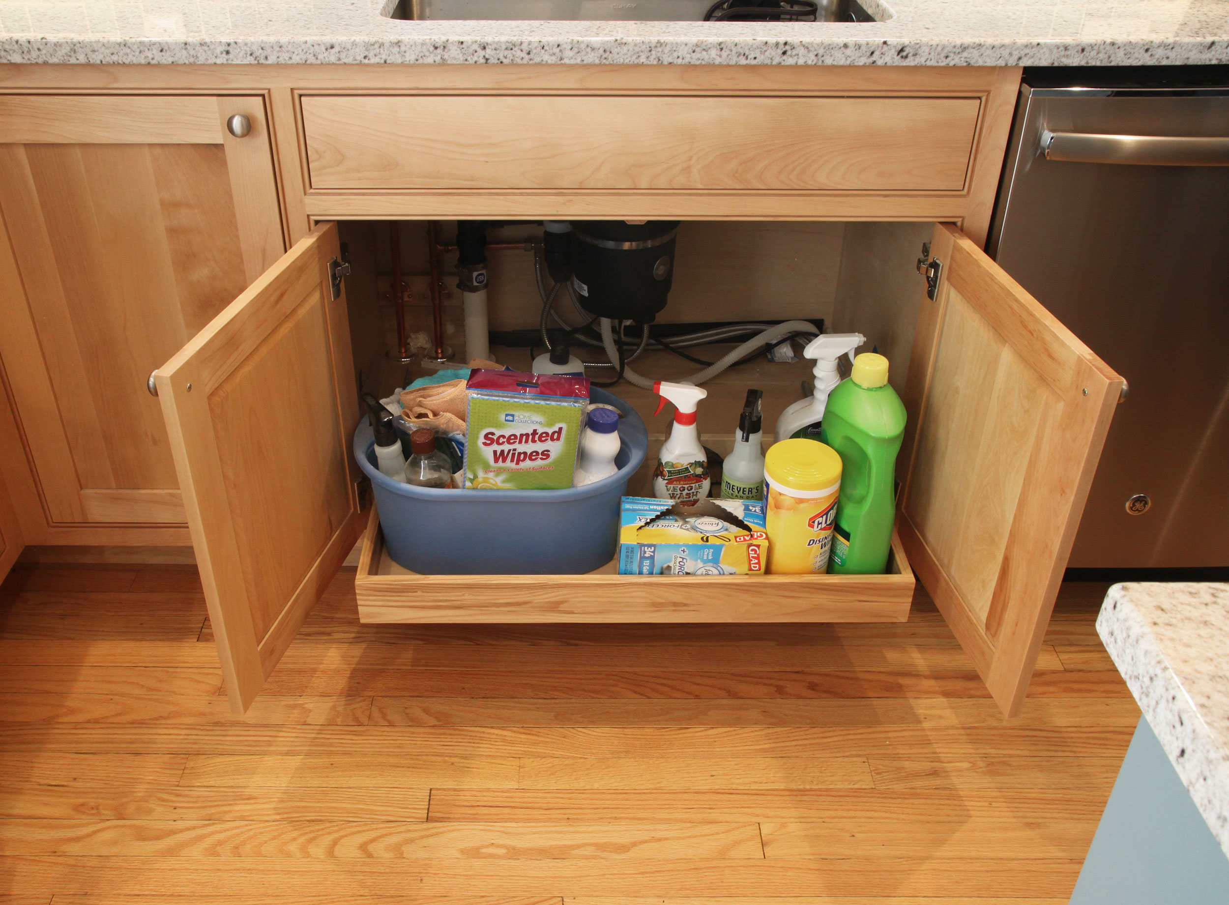 Pullout gives access to cleaning supplies