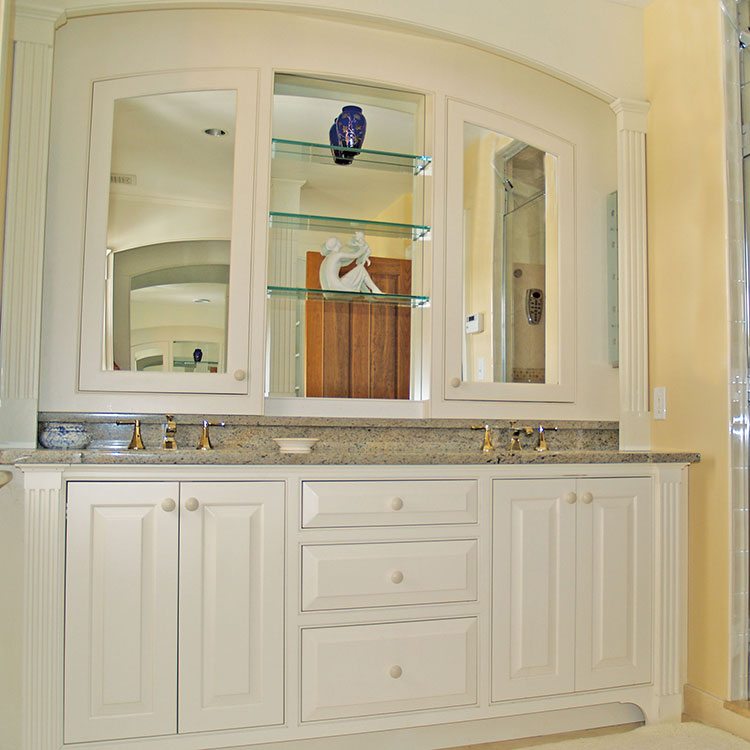 The Arches - This elegant bath surround provides function and style with the mirrored medicine cabinet doors and center mirror with glass shelves. More Pictures