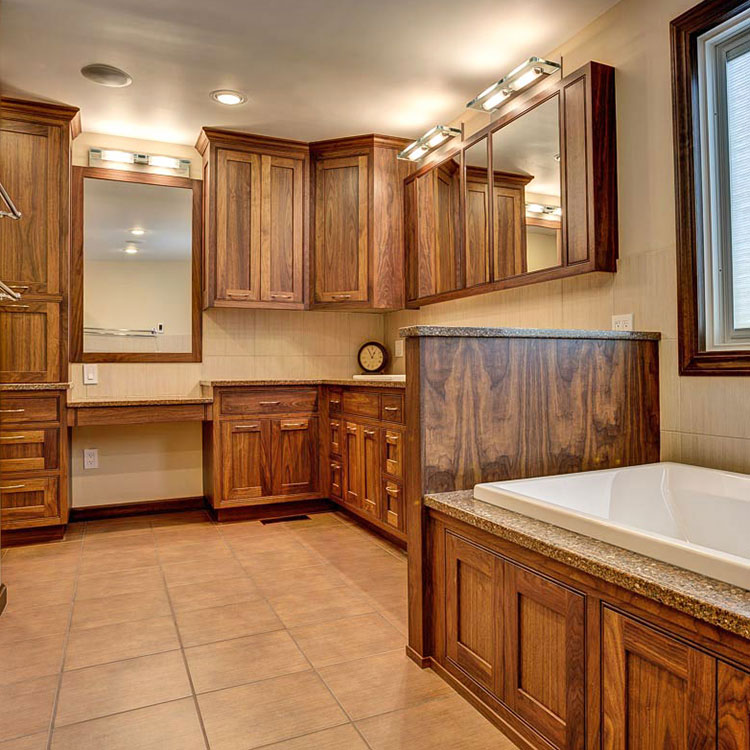 Large Master Bathroom in Walnut - In this spacious master bath for two busy professionals, with his and hers vanities and full makeup station, there is ample cabinetry for all. More Pictures