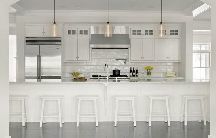 Stunning White Kitchen - This elegant white kitchen brightens the entire house. With a 17' long island there is plenty of room for family and guests to enjoy the space. More Pictures