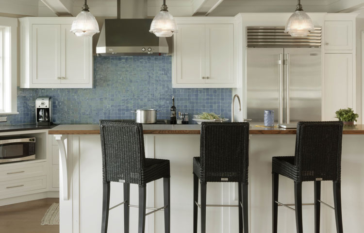 Lakeside Kitchen - Blues and whites bring the sparkling colors of Lake Champlain into this custom white kitchen. More pictures