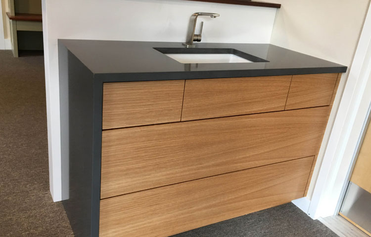 Match grain slab vanity with touchlatch