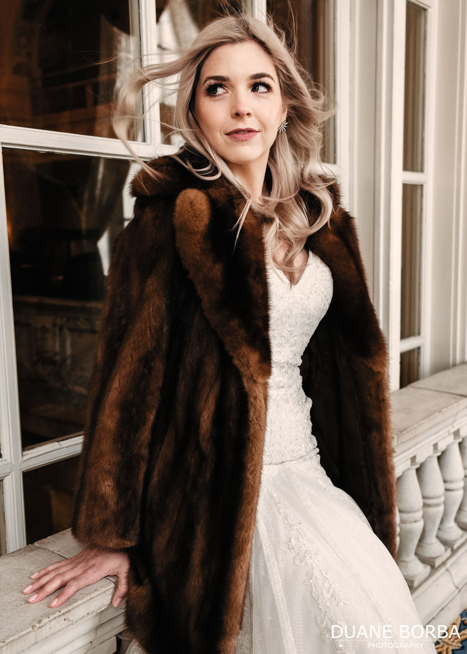 Bridal pose with fur coat in Hermitage Hotel in Downtown Nashville, Tennessee
