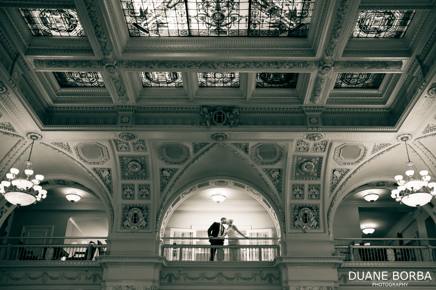 Environmental portrait of bride and groom in Hermitage Hotel in Downtown Nashville, Tennessee