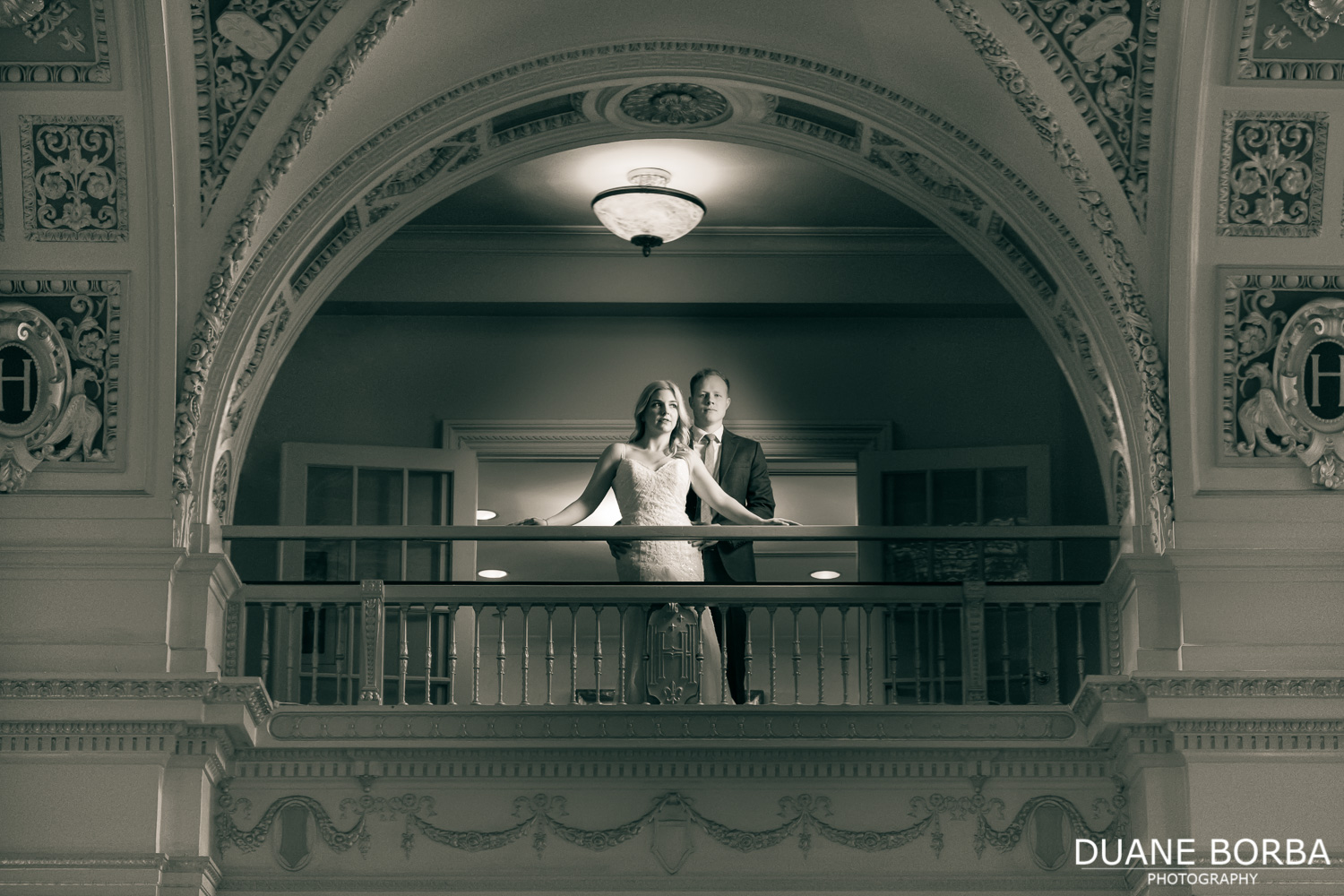 Bride and Groom portrait on balcony inside Hermitage Hotel in Downtown Nashville