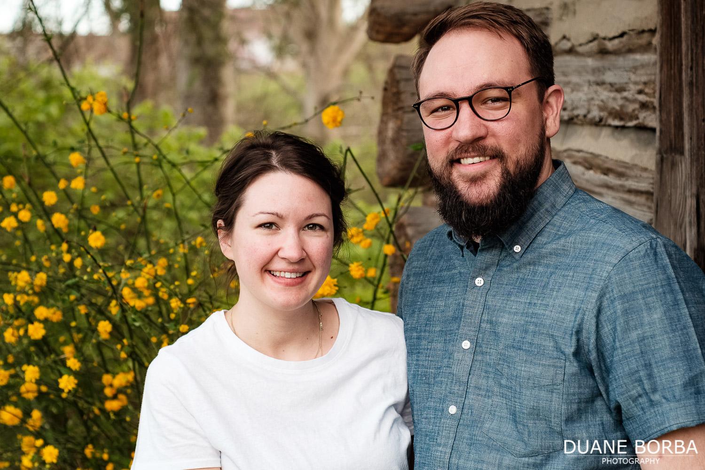 Couple portrait near yellow flowers