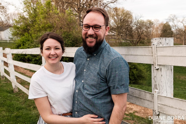 couple portrait near white fence