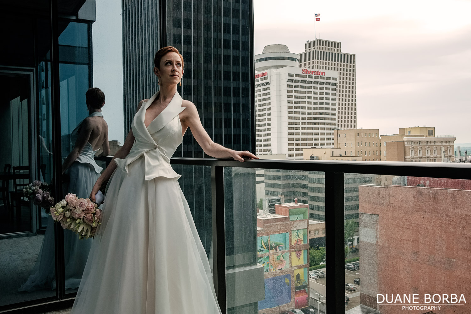 Bride posing on a balcony in Downtown Nashville, Tennessee