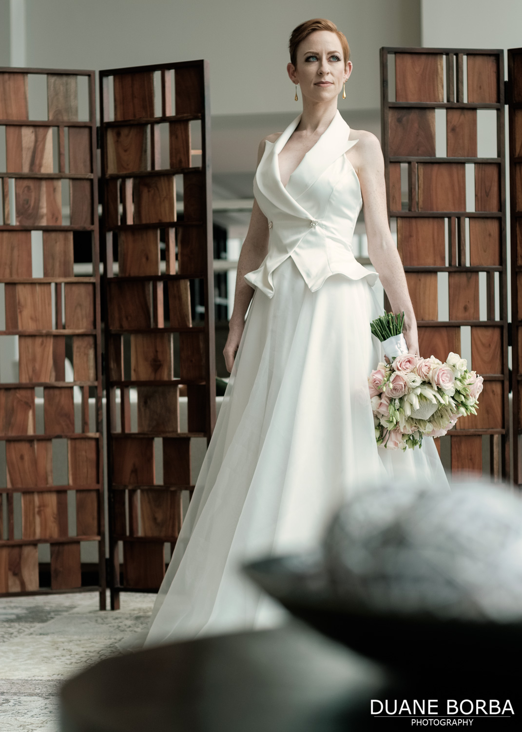 Bride posing with wedding gown and bouquet