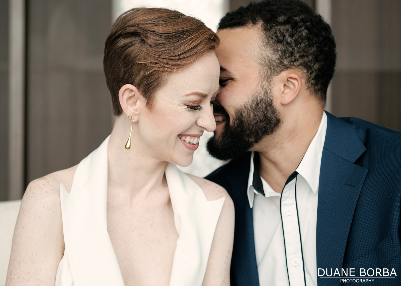 Bride and groom whispering secrets