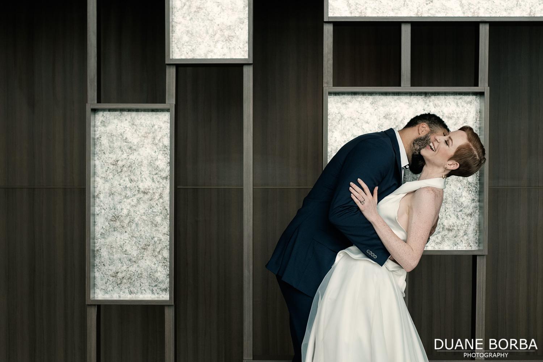 Bride and Groom embracing near room divider in 505 Nashville