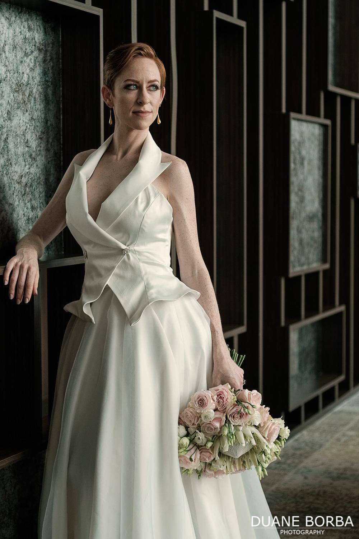 Bride poses along room divider in 505 Nashville