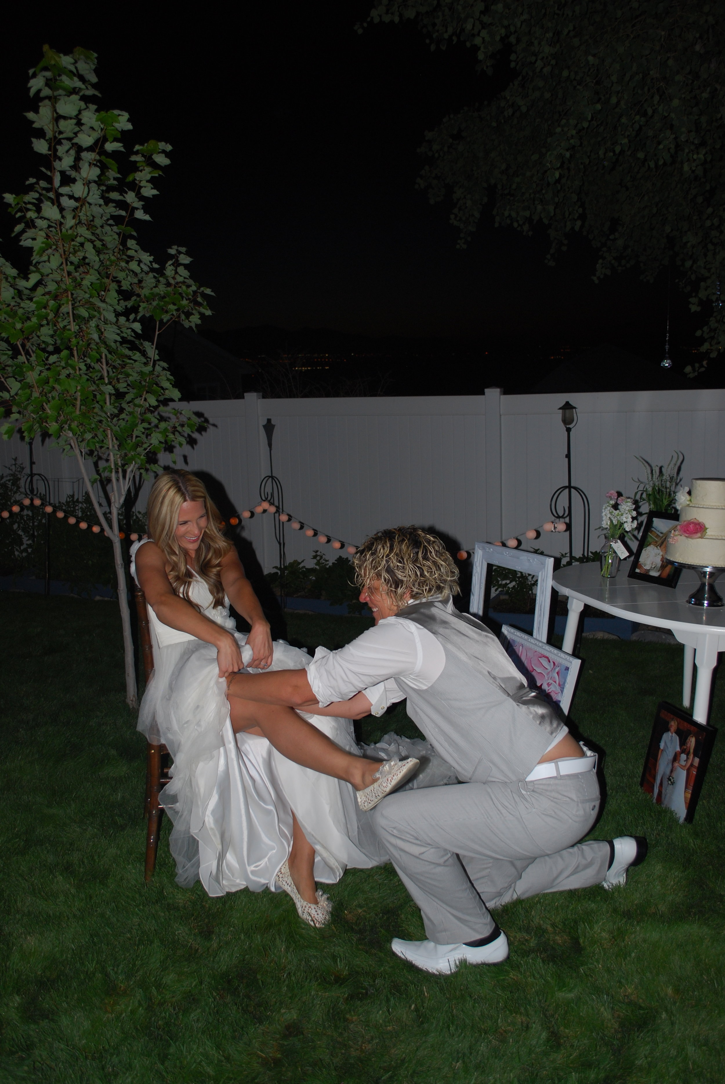 Kris getting the garter belt.I got made fun of because I put it too high, not realizing at the time...Oops! HA!