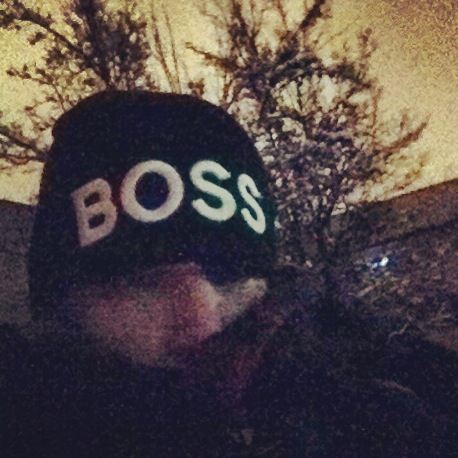 "This is a picture Kris sent me from that night while waiting outside! I felt so bad that it was so cold! But, I couldn't help but feel so grateful that he was so willing to do this for us, and our family! The ""BOSS"" beanie was for Boston!"