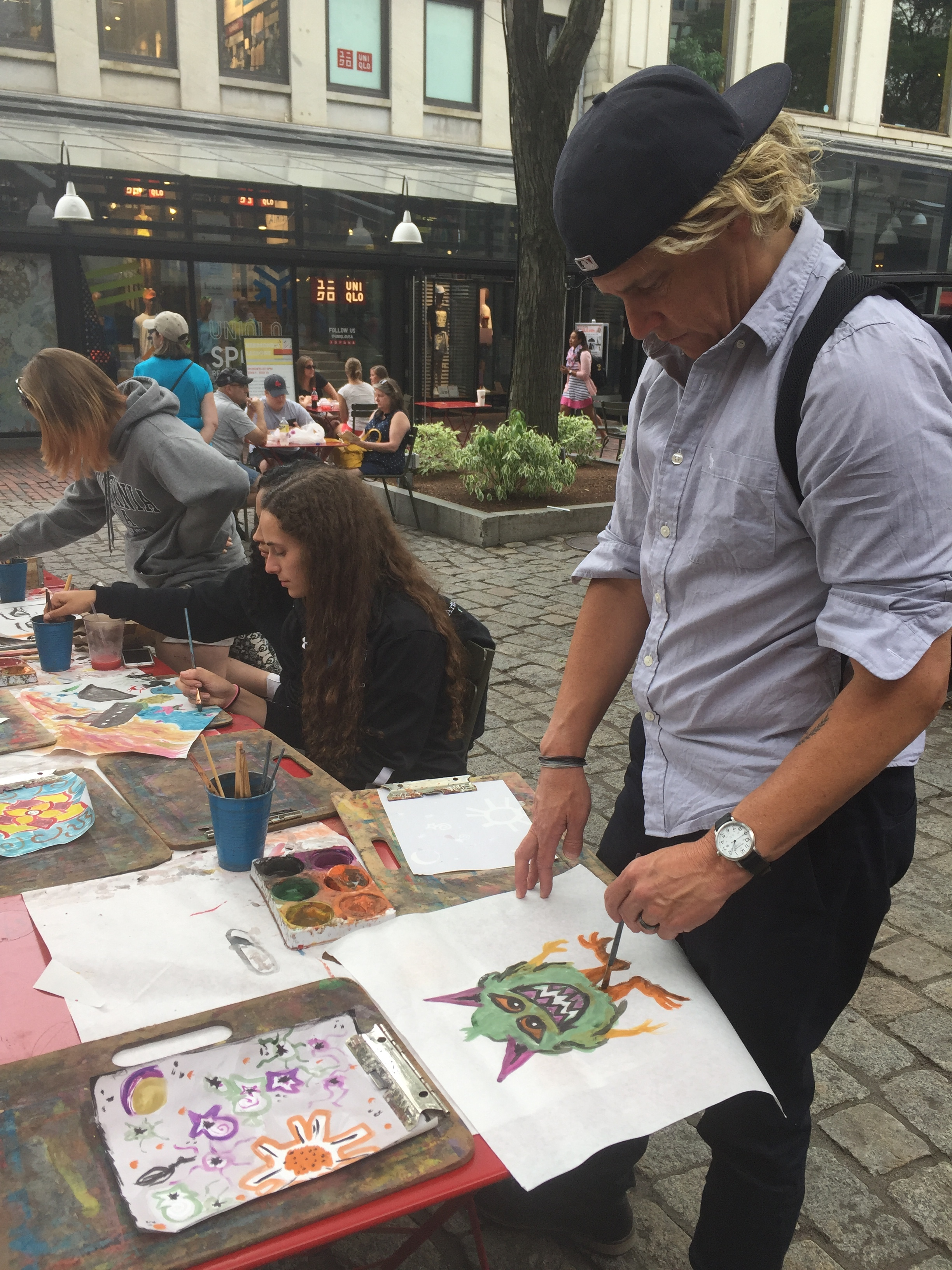 Kris painting Boston something special while at Quincy Market.
