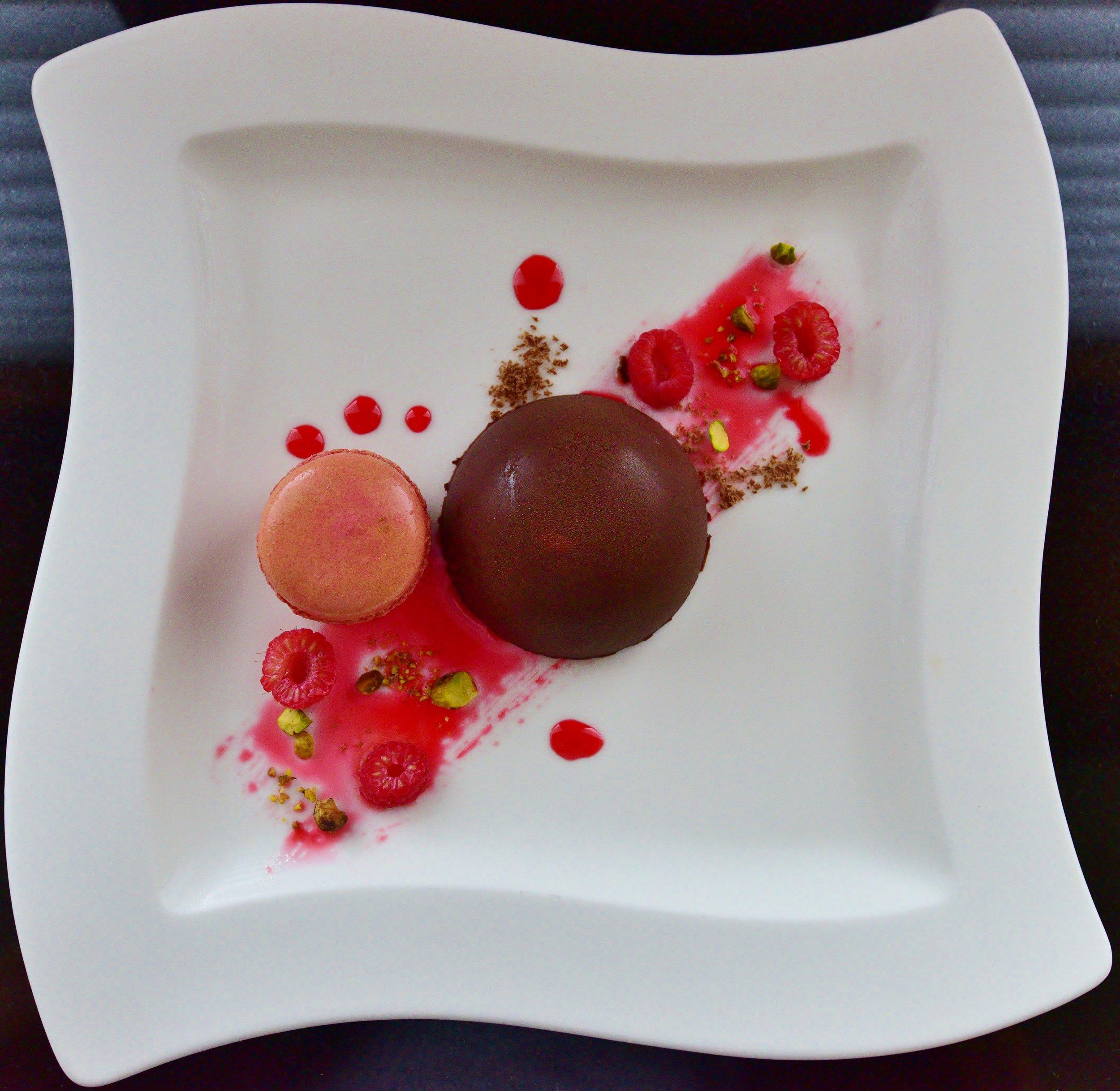 Dessert Chocolate Mousse dome with raspberry curd, pistachio, raspberry macaroon, chocolate shavings & and fresh raspberries..JPG
