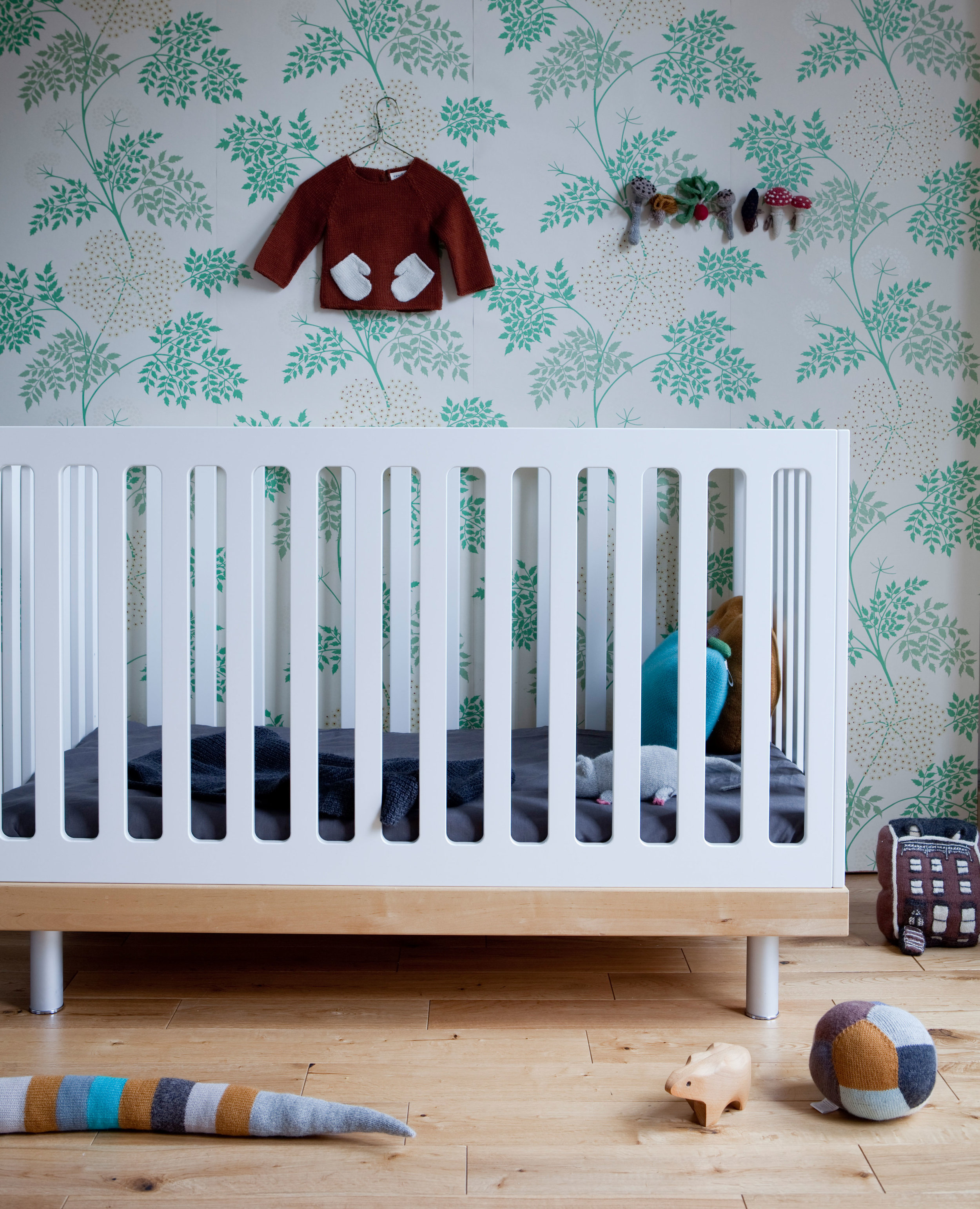 From birth to 5 years, the Classic Cot Bed from Oeuf NYC pairs modern design with practical features. Complete with fixed sides and made from solid birch wood and eco-MDF, the strong and durable bed frame has been designed to better utilise your space. With a smaller footprint than typical cots and a low overall height for easier access to your little one, the classic cot bed is a practical choice for new parents. With 3 adjustable mattress positions, simply lower the mattress height to ensure your little escape artist is kept safe while they sleep. And when they're not so small anymore, convert your cot into an equally stylish 4-sided toddler bed with the conversion kit available separately - making the transition from baby bed to toddler bed a lot less daunting. Quick and easy to assemble and convert, your nursery will be ready in no time! Choose from 2 gorgeous finishes; White and Birch or White and Walnut and pair with matching accessories and bedding to create a soothing space for your new arrival.     Features and Benefits: Nursery cot bed in white and birch finish Made of solid birch and eco-MDF Cot can convert to a 4-sided toddler bed with conversion kit (sold separately) Suitable from 0-5years Easy to assemble by one person 3 adjustable mattress positions Low overall height for easy access Small footprint helps utilise space efficiently Adjustable legs for uneven surfaces.