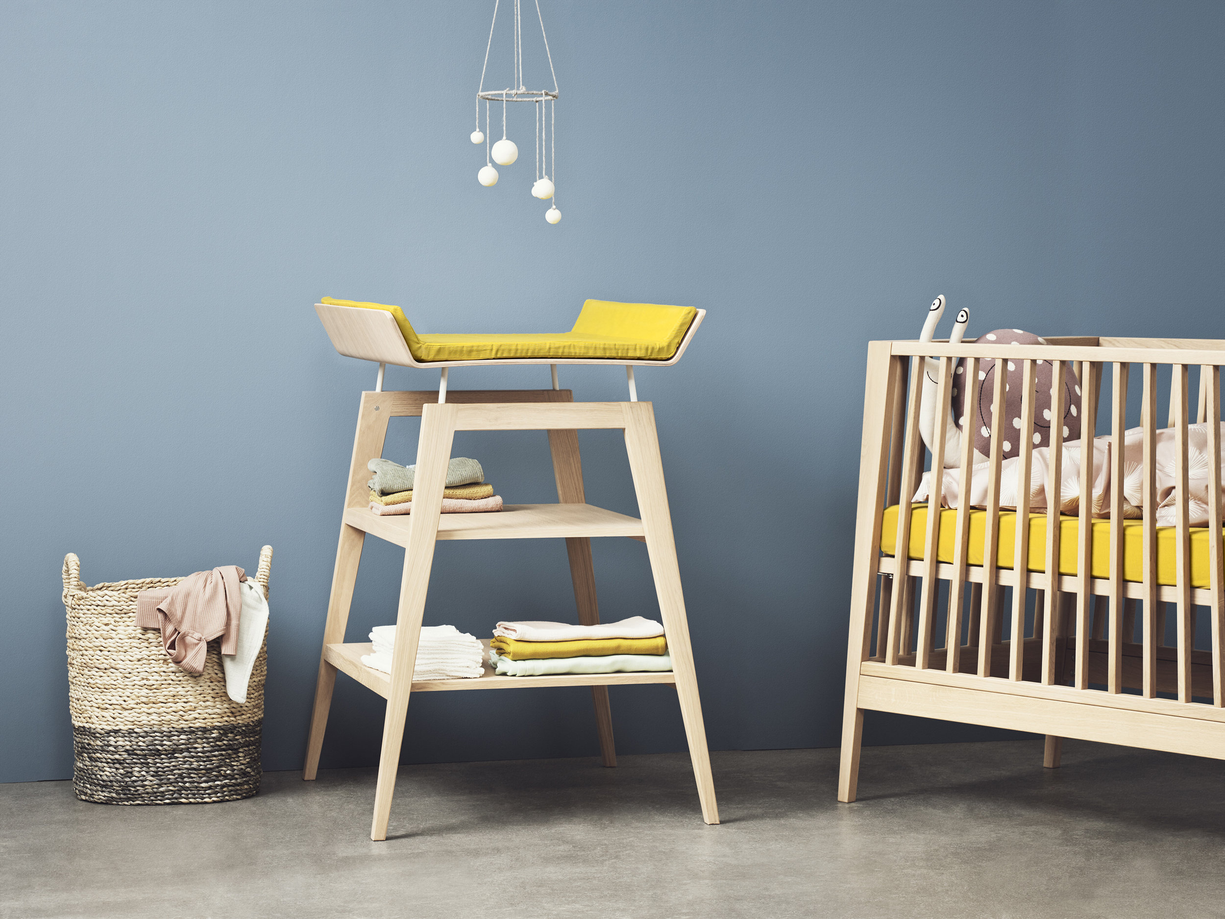 This Linea Changing Table with Foam Mat in Solid Oak by luxury nursery furniture designer Leander is just one of the fabulous products we are delighted to add to the Cuckooland nest. Designed and made in Denmark, these quality innovative pieces add a touch of class to any child's bedroom. Linea means line. The collection reflects its name with clean sharp lines and an edgy urban feel yet still remaining feminine, sophisticated and soft. Whilst changing a baby's nappy, you are given precious quality time to spend with your little one.     The Changing Table is a place for cuddles, giggles, heart melting and making memories. And let's face it, anything that can make the not-so-pleasant job of bottom wiping more bearable is money well spent! Part of the Linea nursery range, this contemporary changing table has safety at its core with raised sides to prevent your baby from rolling off the edges. Its height can also be adjusted so that whoever lands the task of nappy duty is able to work comfortably at an optimal height ensuring there are no aching backs (to go with the sleepless nights!) No child should ever be left unattended on a changing table, so the handy shelves have been designed to allow you to easily reach all essential bits and bobs you might need without having to leave the baby changing zone!