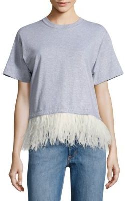 Simple t-shirts with a wow factor detail is my favorite look for fall. I have paired this with black pants and heels and with jean shorts and flats.