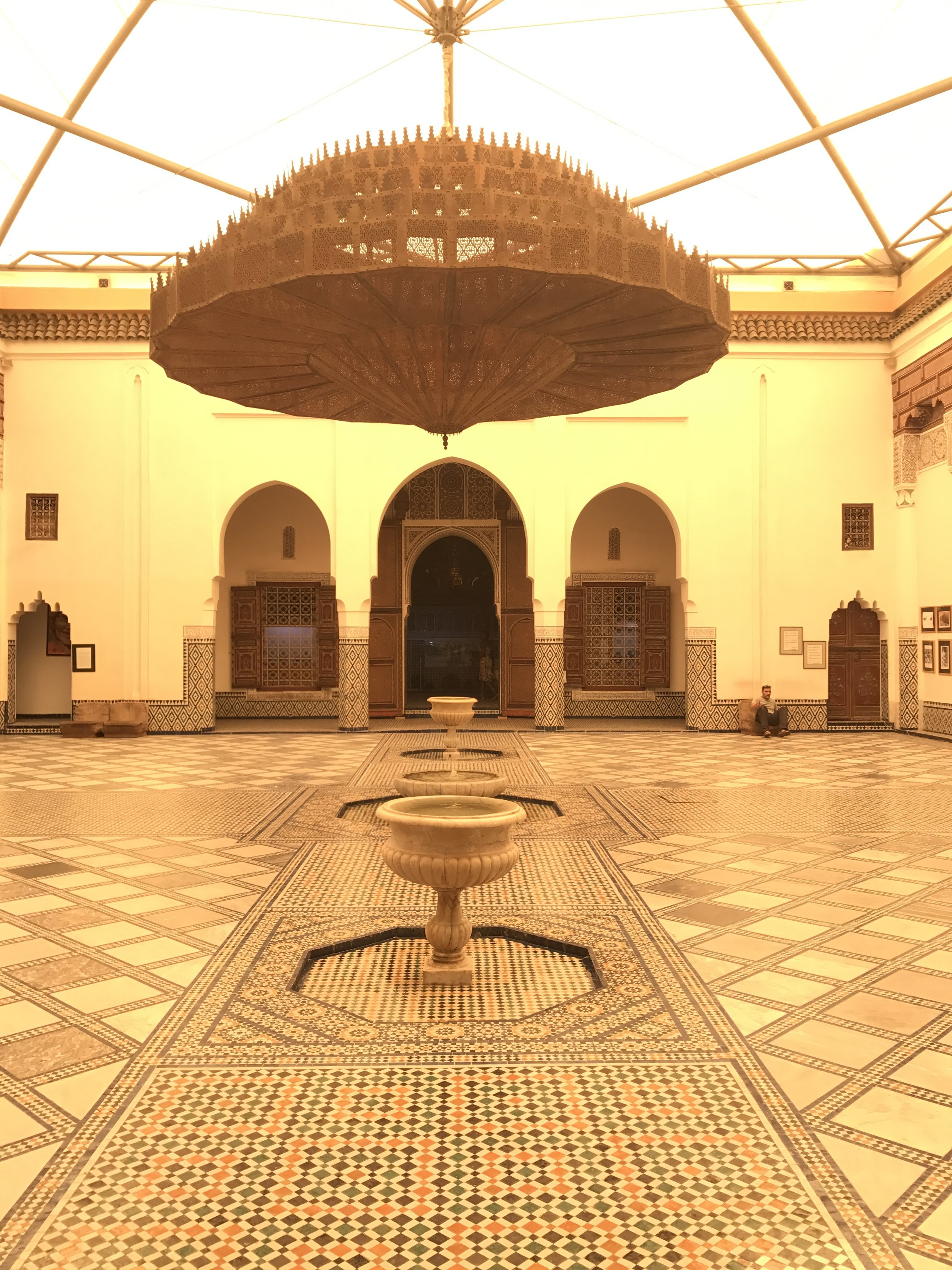 Hand carved metal chandelier in the central courtyard of Marrakech Museum.