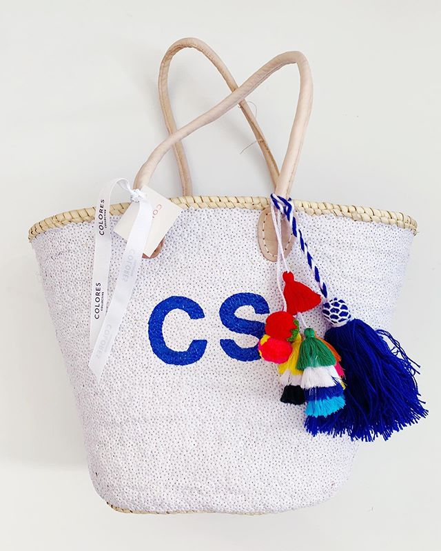 It's been a minute since we've seen a bag around here! So what better tote to showcase than this YSL blue on white with the new navy & white tassels and a pop of color from the Bali! #TakeMeToTheBeach
