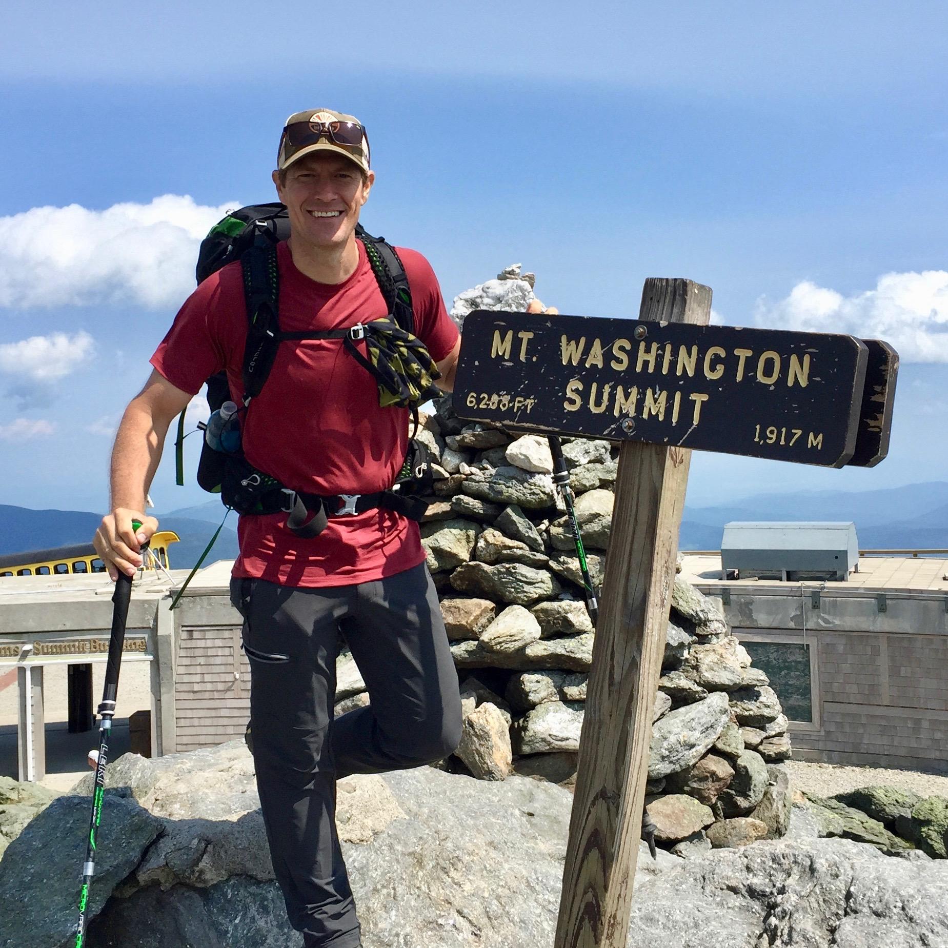 Tour leader Randy Propster atop New Hampshire's Mount Washington