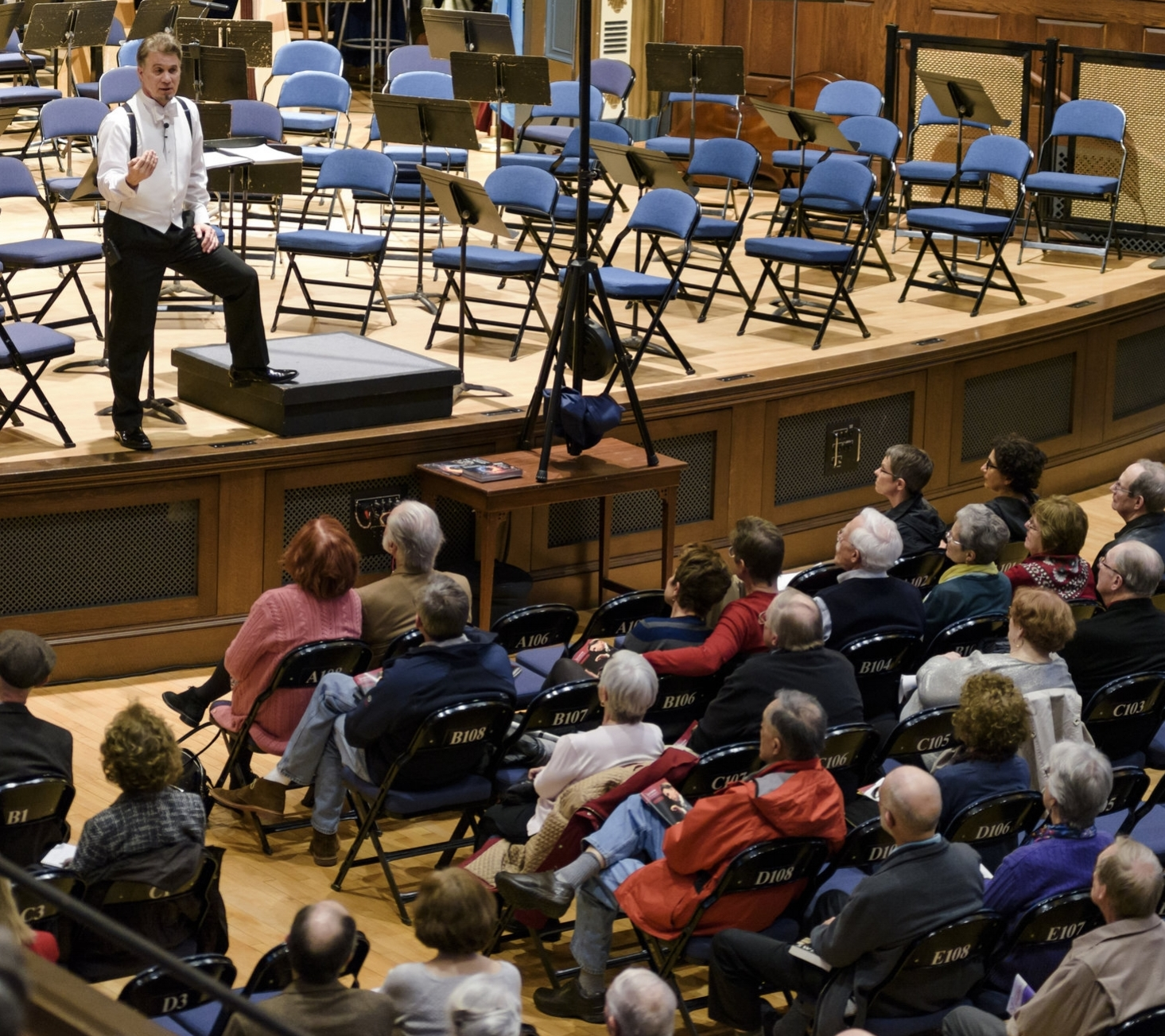 McPhee engaging with audience members during a pre-concert Conductor's Talk.
