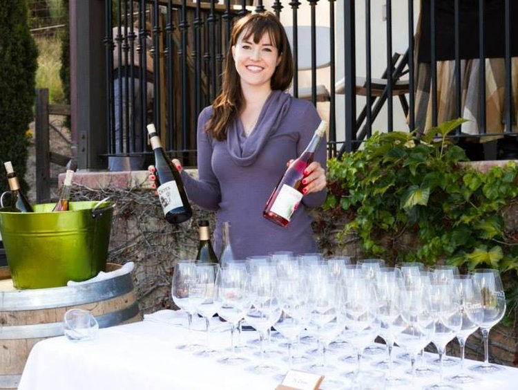 Anna pouring at the vineyard venue for a wine club event