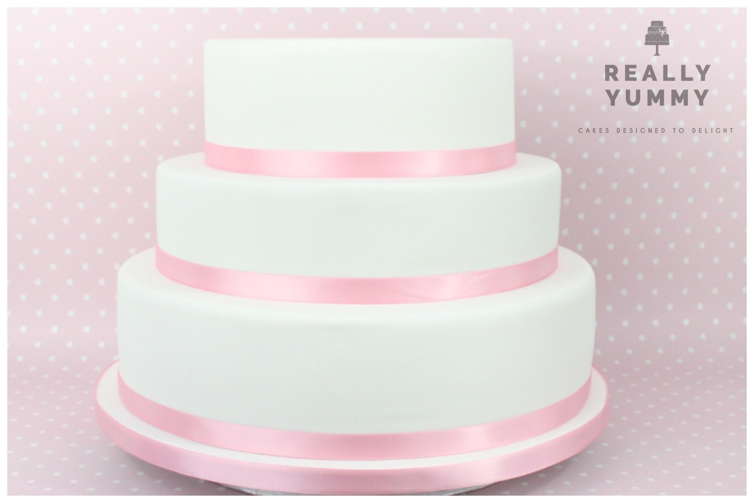 Wedding cake, with pink ribbon
