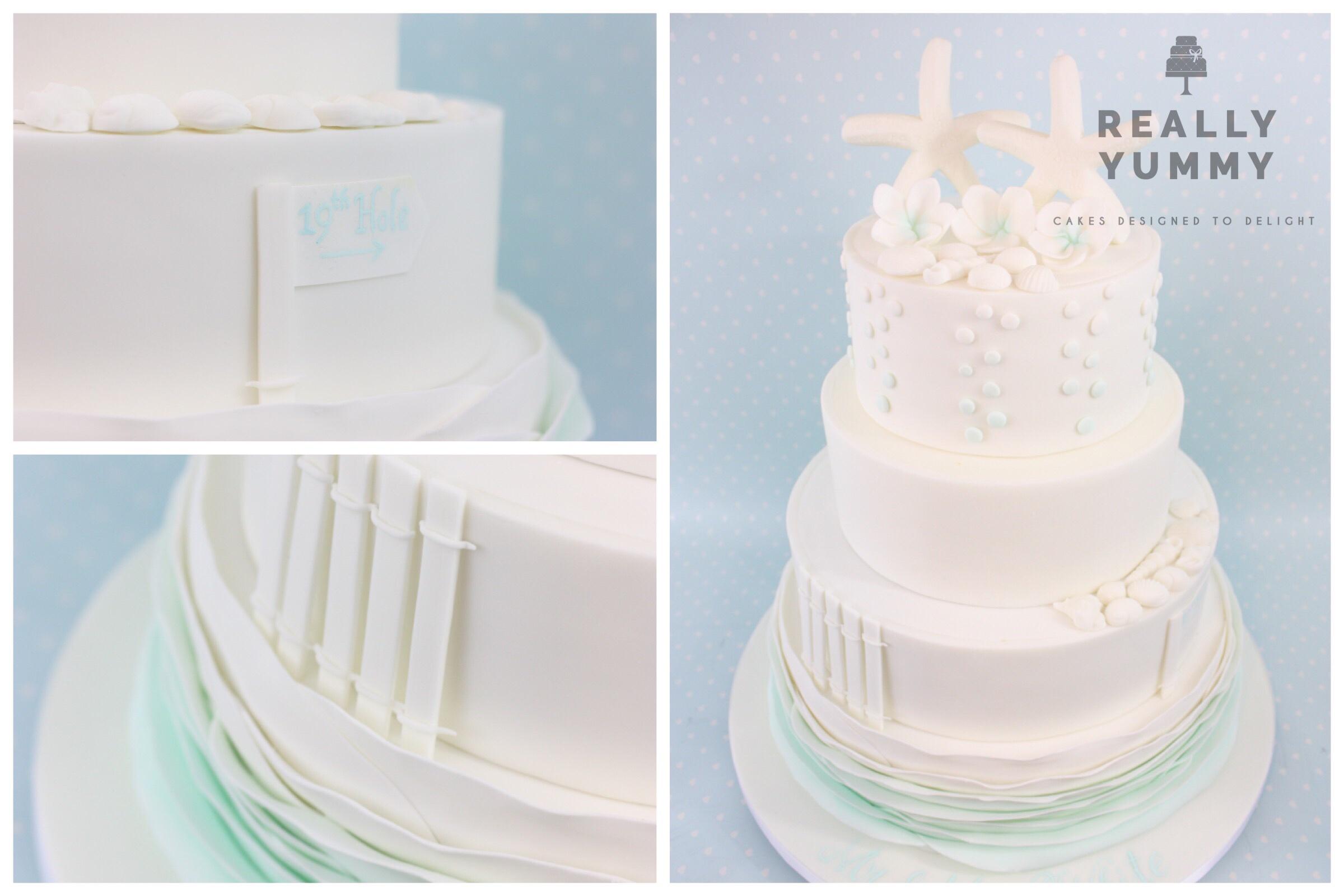Beach-themed wedding cake, with starfish and shells