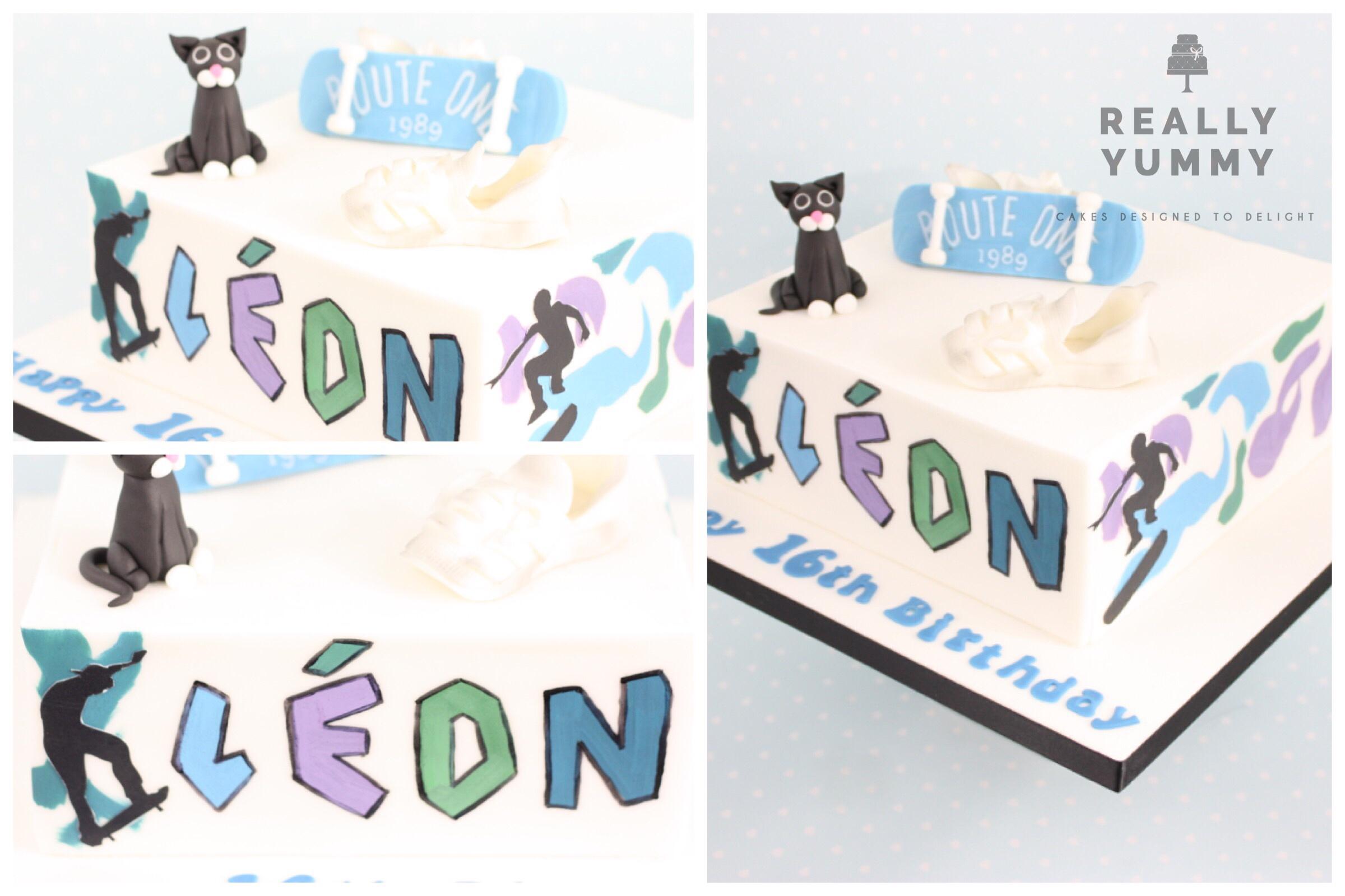 Skateboarding cake, with graffiti and black cat