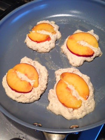 It's OK if the peaches look bigger than the pancakes at first, the batter will spread.