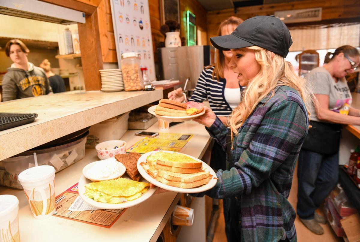 Waitresses run hot breakfast orders to patrons at the Waveland Cafe in Booneville.