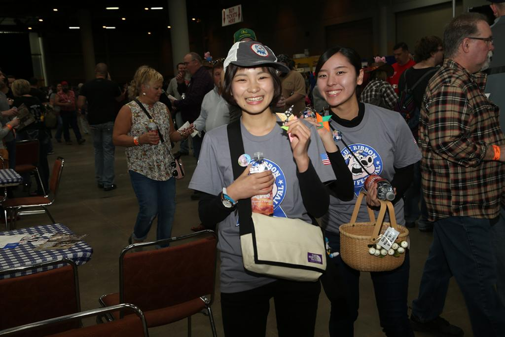 Guests from the Bacon Delegation enjoy the Blue Ribbon Bacon Festival in 2017.