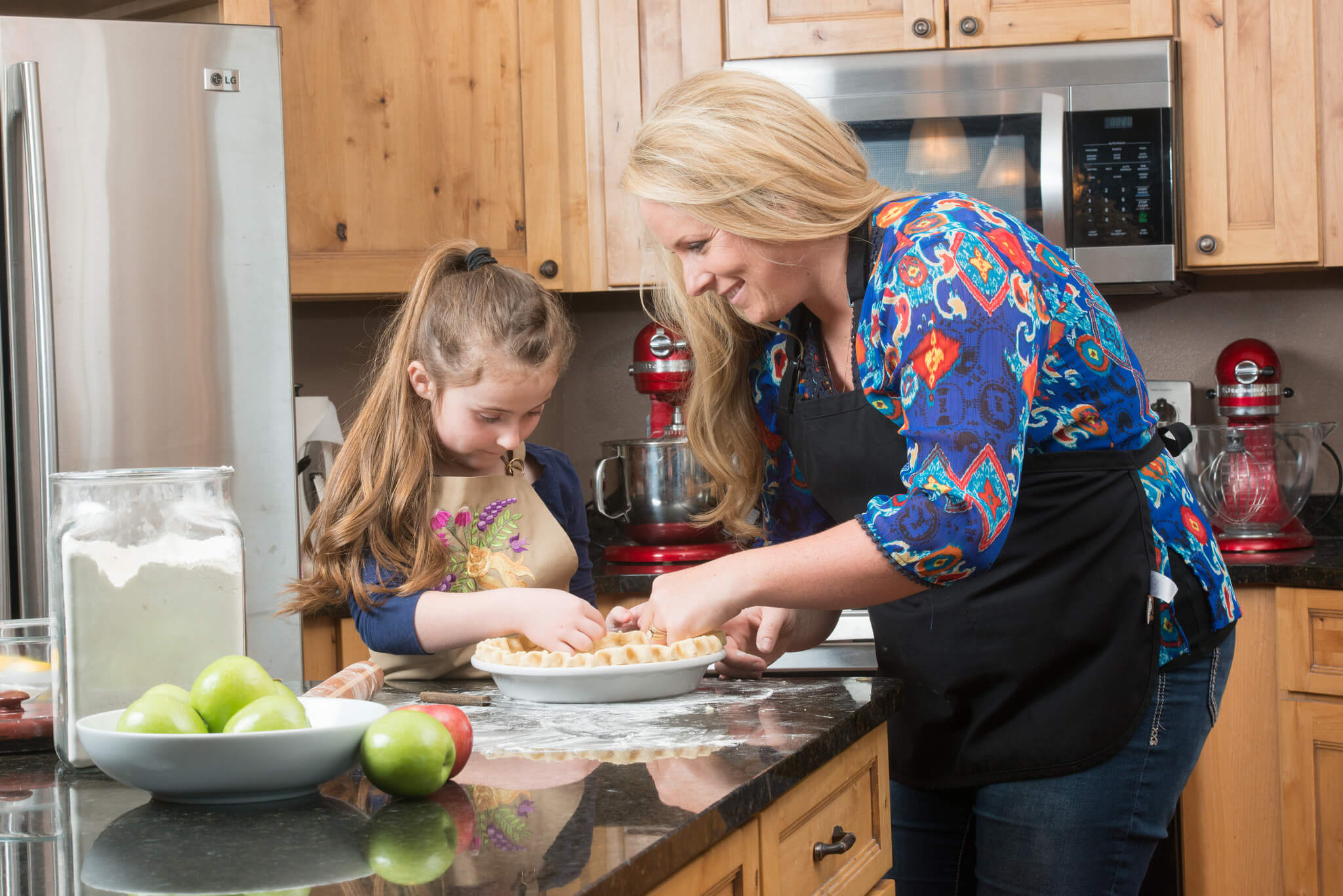 Cristen Clark bakes a pie with her daughter.